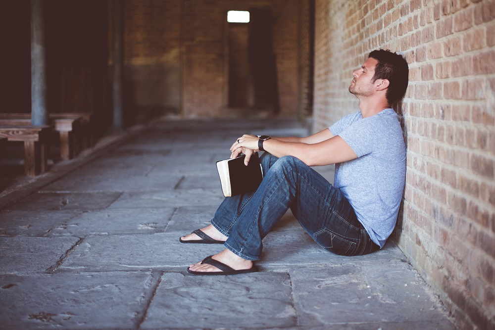 Man sitting with Bible