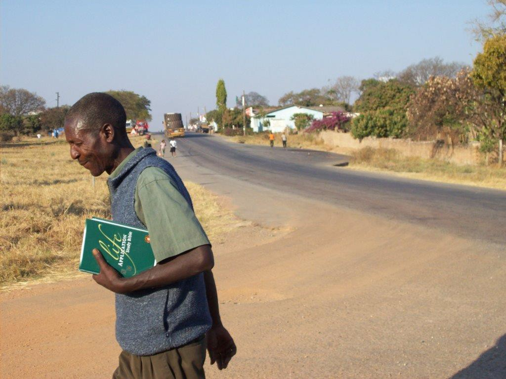Rural pastor in Zambia leaving the LASB training with a new LASB.