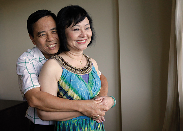 Kim pictured in a smiling embrace with her husband Toan. She found forgiveness in the hardest of circumstances.